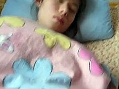 Some perv films on as he explores the bushy pussy of a sleeping girl and then jerks off.