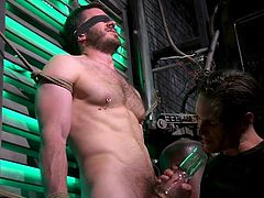 Vander Pulaski cannot move, cannot see, as he is blindfolded, he can only feel. He can feel like two guys take turns working on his big dick, sucking on his swollen balls and licking the tip, but this is only the beginning of cruel torture...