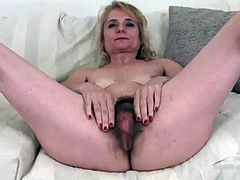 Mature slut . There she is this naughty 50+ yr old slut showing her hairy pussy online in this High Definition scene . Enjoy today