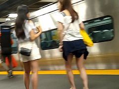 Cute Asians waiting for the train