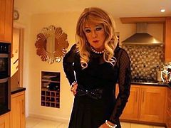 Sidy in black top and black mini skirt